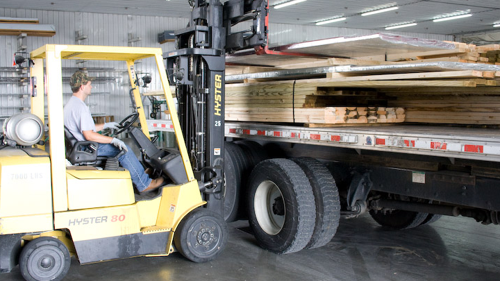 man loading delivery truck with building materials
