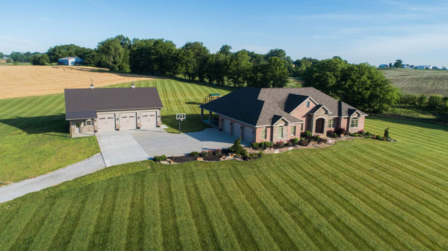 large home with new residential pole garage