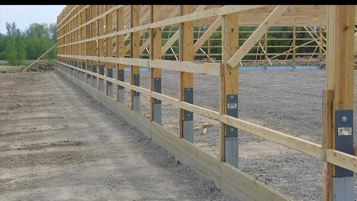 anchor brackets on building foundation