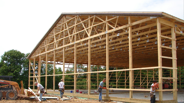 pole barn contractors working on a building