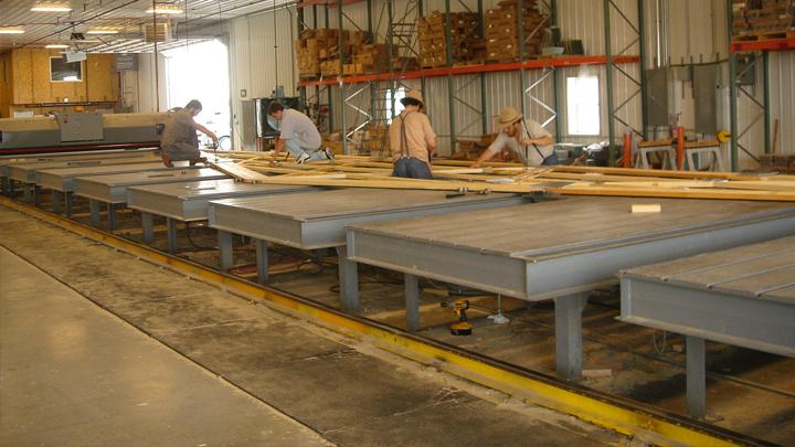 amish contractors assembling pole barn supplies