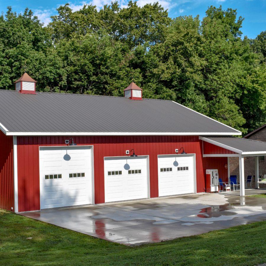 new garage with black metal roof