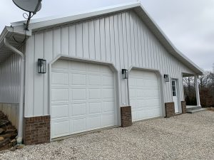 white board and batten siding on two car garage