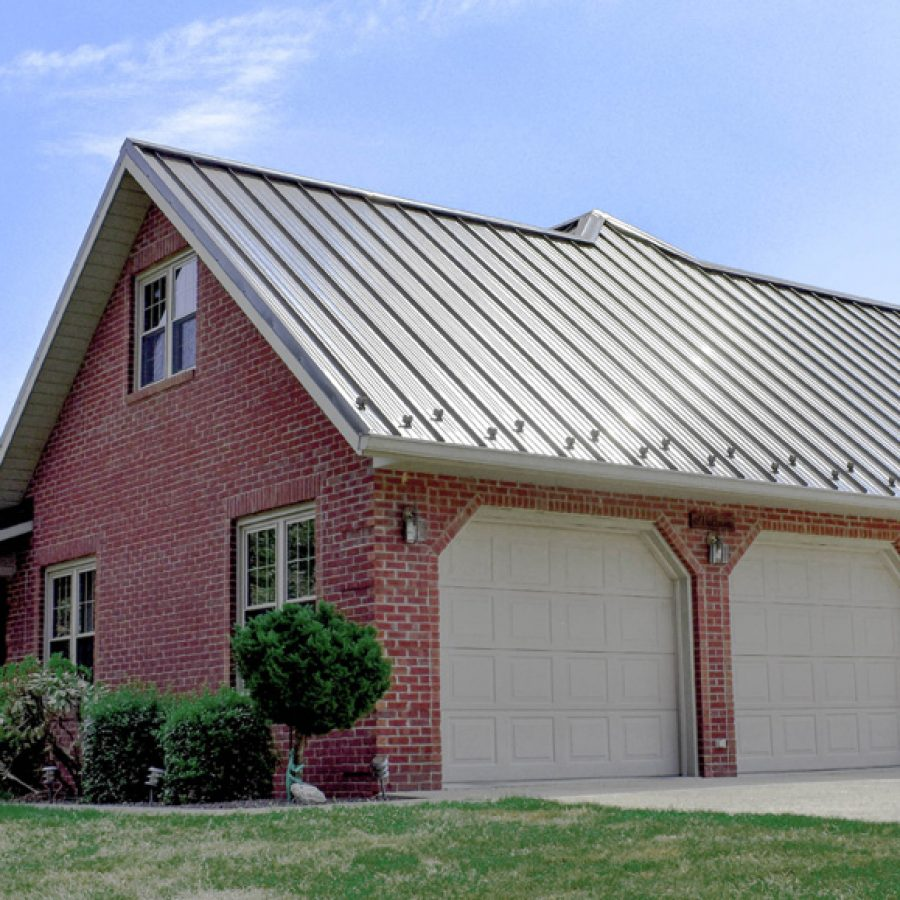 brick garage with attached sunroom