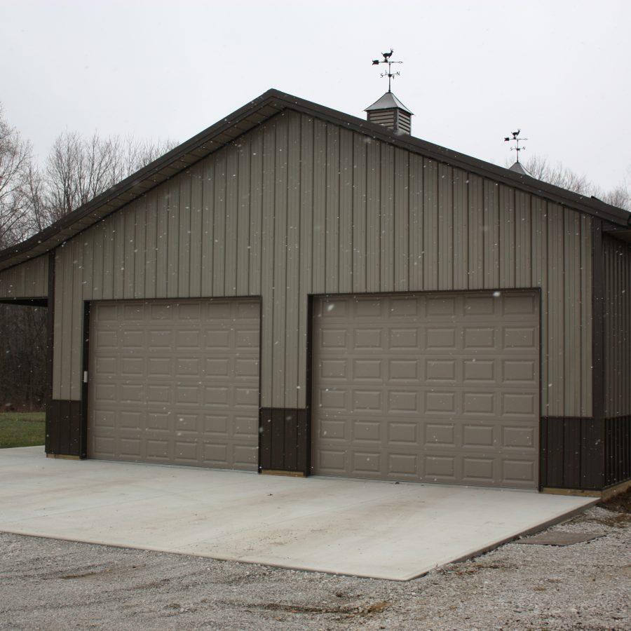 new post frame garage with overhead doors
