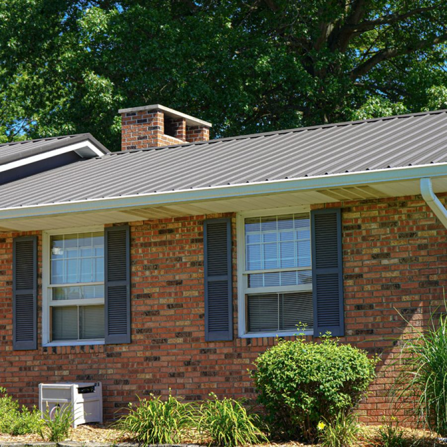 metal roof on brick sided home