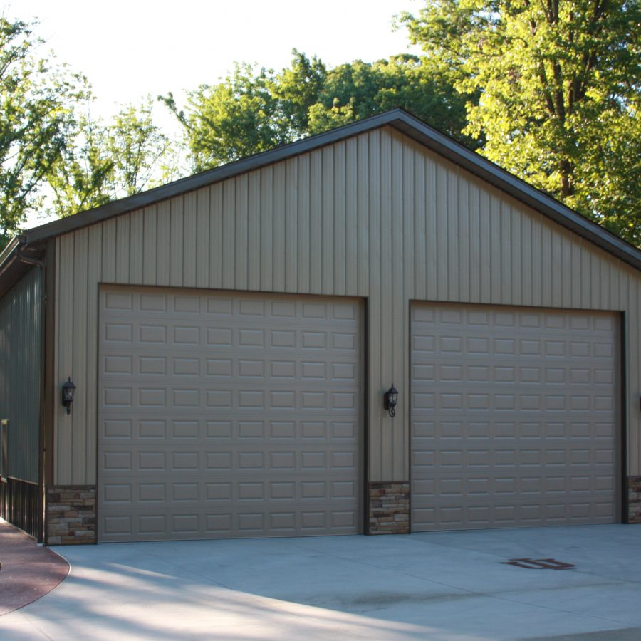 tan metal and affinity stone sided pole garage