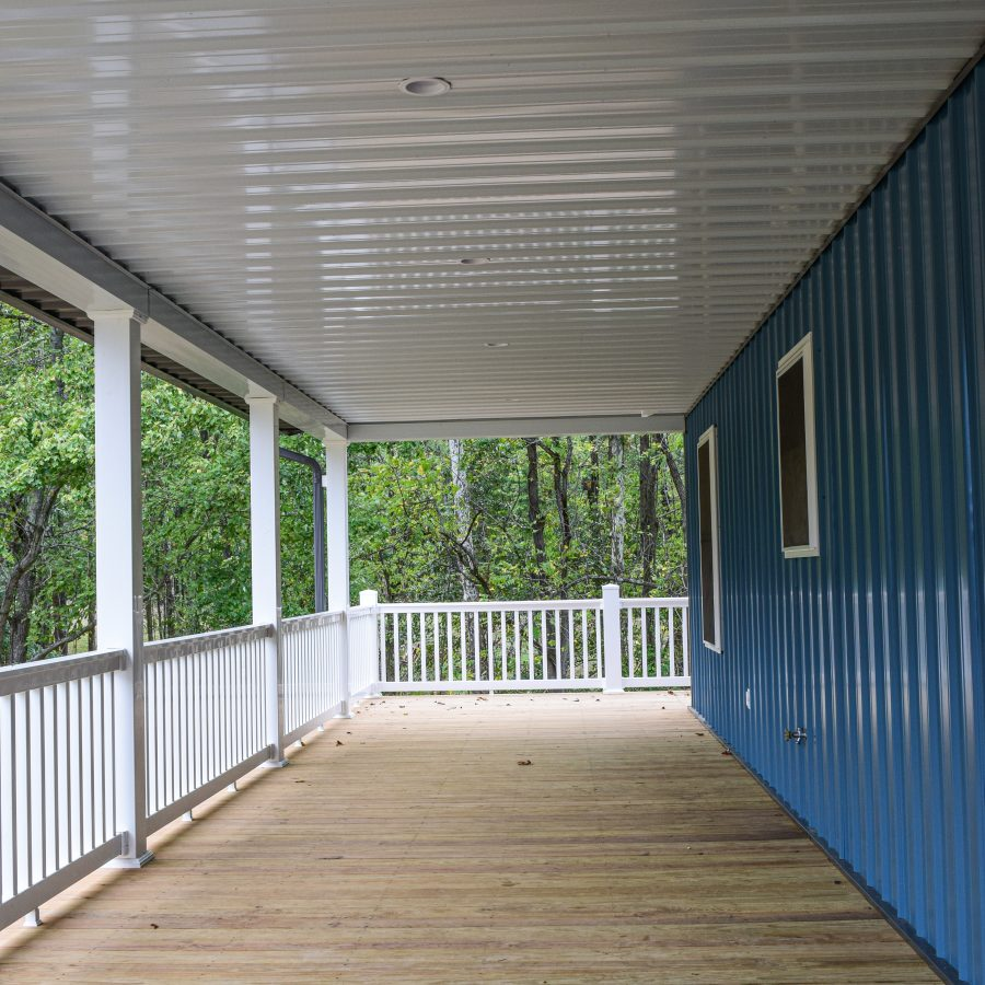 wooden porch and railing attached to new building
