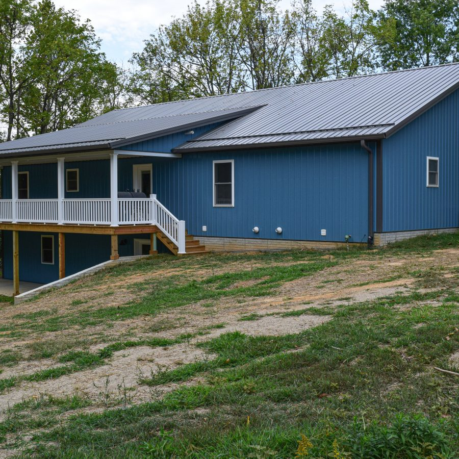 new teal blue two story post frame building