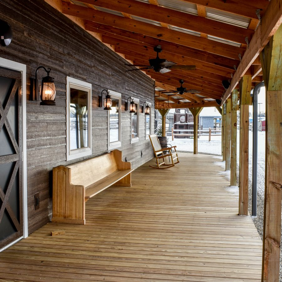 attached wooden deck wtih overhang on store